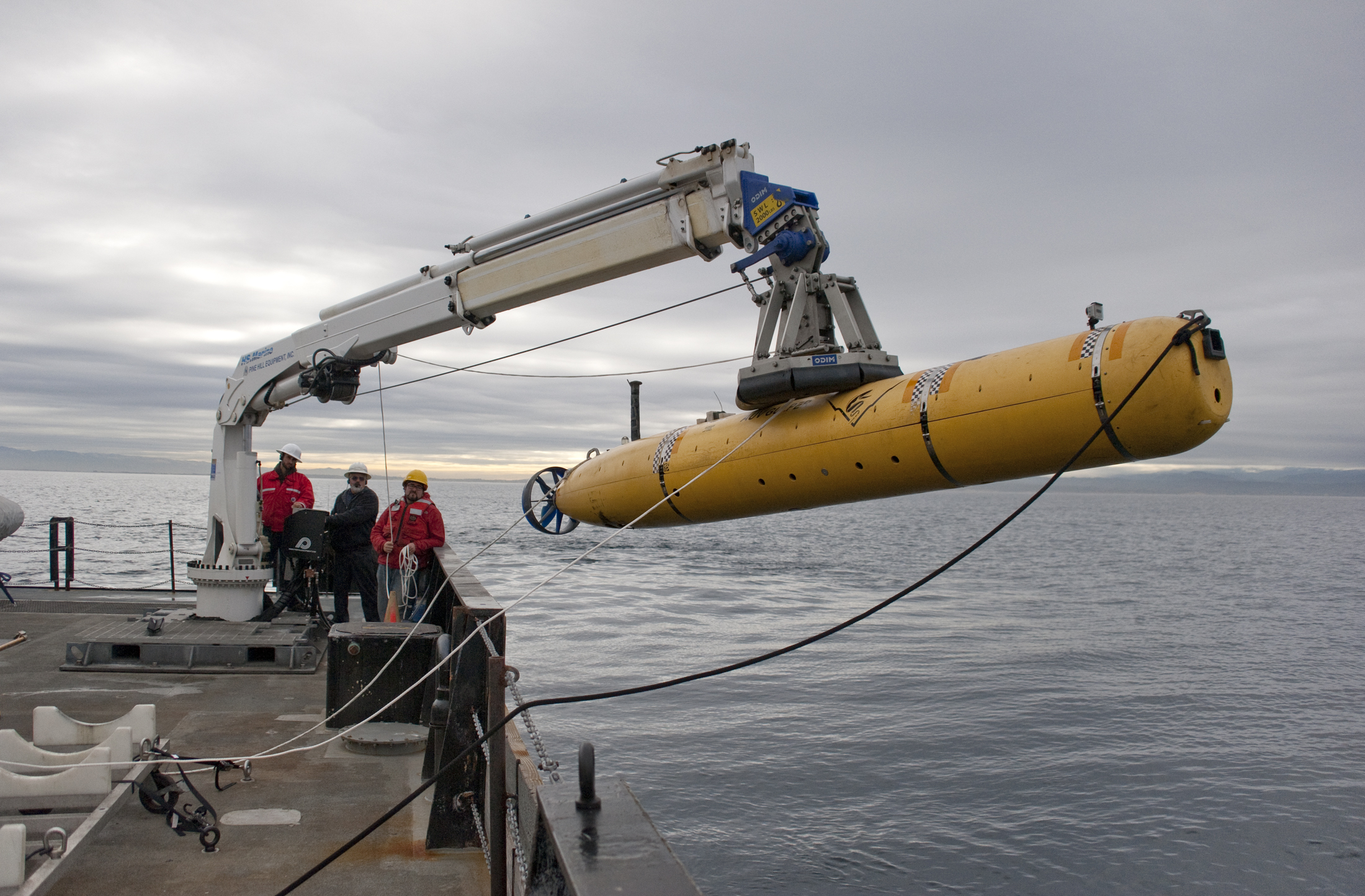The autonomous underwater vehicle (AUV) being deployed on the R/V Rachel Carson in 2012.