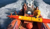Engineer Brett Hobson and Research Specialist Chris Preston on their way to launch the AUV containing a new genomic sensor.