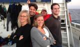 The Haddock lab poses: Lynne, Meghan, Steve, Alex (the photobomber is Randy Prickett).