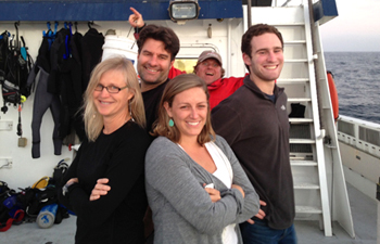 The Haddock lab poses: Lynne, Meghan, Steve, Alex (the photobomber is Randy Prickett).