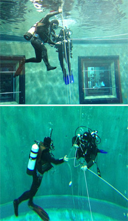 Steve Haddock and Stephan Siebert practice setting up and attaching to the line for blue-water diving in MBARI's test tank. Danielle Haddock took these photos through the windows of the conference room adjacent to the test tank during the check-out dive.