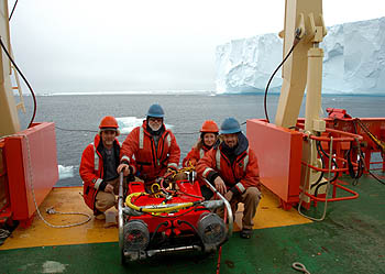 This team of marine biologists from the Monterey Bay Aquarium Research Institute used a small remotely operated vehicle to examine undersea life in the vicinity of two icebergs in the Weddell Sea. From right to left, the members of the ROV team were Kim Reisenbichler, Bruce Robison, Karen Osborn, and Rob Sherlock. Image: (c) 2005 Bob Wilson