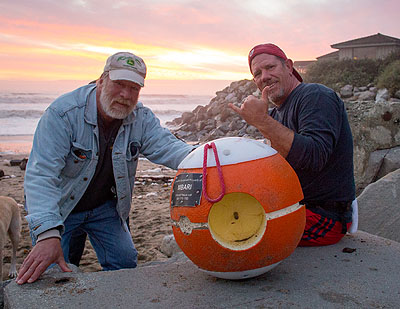 The two beach-goers found one of MBARI's Benthic Event Detectors on a beach in Santa Cruz. Image: Brian Kieft