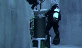Two divers check out the second-generation ESP in MBARI's test tank before an early 2006 deployment. The ESP works well identifying proteins and other gene products in surface waters. The design team is now working to make the system function at 90 times surface pressure, and to allow the ESP to sequence DNA. Image: Todd Walsh, MBARI.