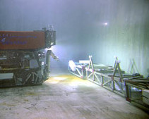 This photo shows the flume for the FOCE experiment underwater in the MBARI test tank, along with the remotely operated vehicle Ventana. Seawater enriched with carbon dioxide will be sent down this flume, mixing as it goes. In the center of the flume is an open area where animals on the seafloor would be exposed to the slightly acidified seawater. Image: Todd Walsh, ©2008 MBARI.