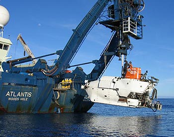 The human-occupied submersible Alvin is launched from a special crane on the transom of the research vessel Atlantis. The R/V Atlantis is operated by Woods Hole Oceanographic Institution and is used by scientists from around the world. Image: (c) 2005 Mark Spears