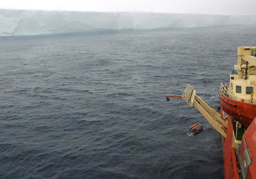 ROV IceCUBE is lowered into the sea on a wet, blustery day. Photo by Vivian Peng.