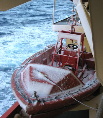A coating of snow collects on a workboat located below the starboard lifeboat. Photo by Gordy Stephenson.