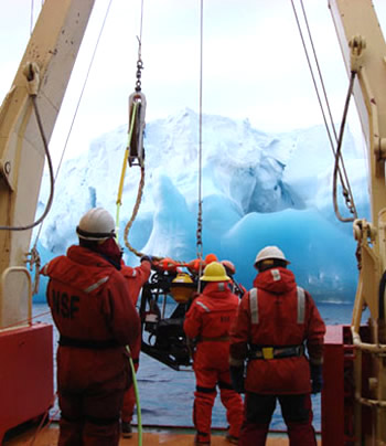 ROV IceCUBE  dives near a small iceberg. Photo by Cole Hexel.