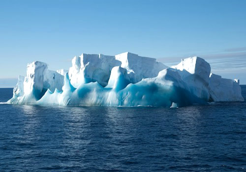 A small iceberg with old blue ice that was chosen for an ROV dive. Photo by Debbie Nail Meyer.