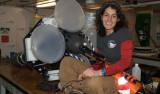 Engineer Alana Sherman rebuilds a Lagrangian sediment trap between deployments. Photo by Debbie Nail Meyer.