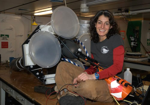 Engineer Alana Sherman rebuilds a Lagrangian sediment trap between deployments. Photo by Debbie Nail Meyer.