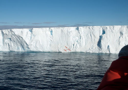 A remote-controlled airplane delivers a GPS tag to an iceberg under study in the Weddell Sea.
