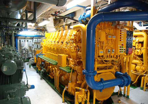 One of four 8-cylinder diesel engines powering the ship. Two engines are connected to each shaft and propeller. Credit: Johnny Pierce.