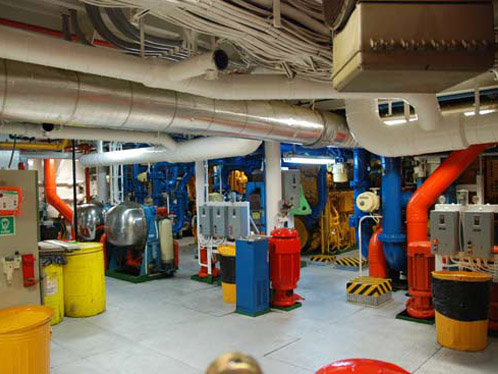 Color-coded pipes and machinery weave through the lower deck. Credit: Johnny Pierce.