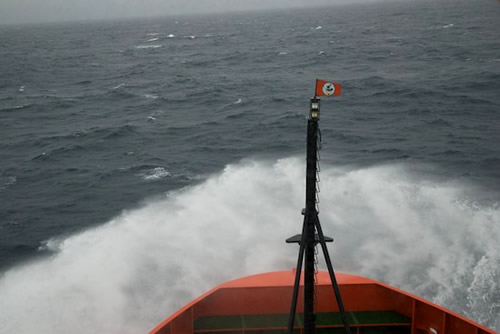 Waves break over the bow of the RVIB Nathaniel B. Palmer as it crosses the Drake Passage. Photo by Debbie Nail Meyer.