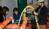 Stephanie Bush, Alana Sherman, & Paul McGill ready ROV IceCUBE  for deployment.