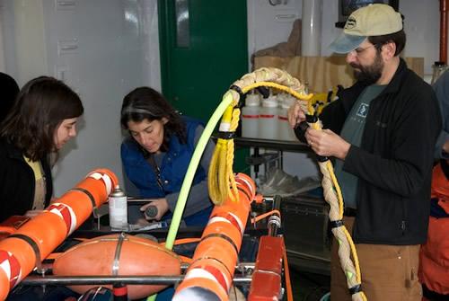 Stephanie Bush, Alana Sherman, & Paul McGill ready ROV IceCUBE for deployment.