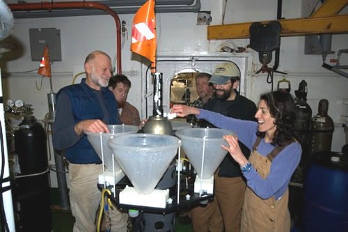 LST team celebrates the first deployment of the instrument under an iceberg. Photo by Debbie Nail Meyer.
