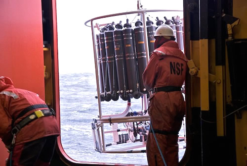 A CTD rosette is lowered into the ocean on a rough day. Photo by Debbie Nail Meyer.