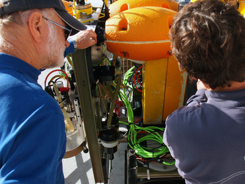 Ken Smith and John Ferreira examine the Rover during its day at the surface. The Rover will be deployed back to the seafloor for another five months tomorrow morning. Photo: Carola Buchner.
