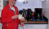 "Maria Vernet gets a cup of coffee at ""Cafe Vernet"" on the ship. Photo by Ron Kaufmann."