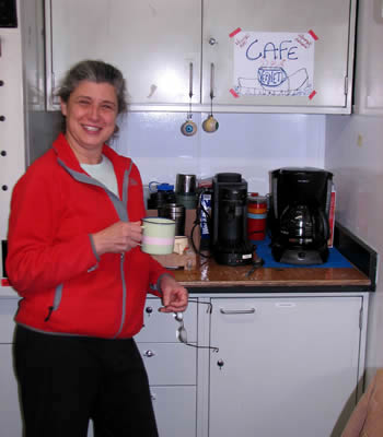 Maria Vernet gets a cup of coffee at
