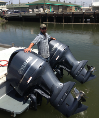 Ocean Observatory Technician Jared Figurski with the new twin 350-horsepower engines on the Paragon.
