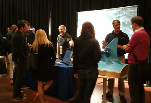 Thom Maughan, second from right, recently displayed the shark fin at a booth at the EG10 conference at the Sunset Center in Carmel, CA.