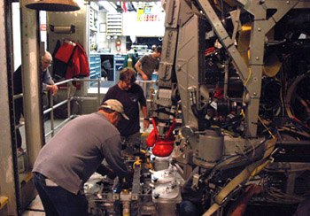 Kim Reisenbichler and Randy Prickett install the Midwater Respirometry System (MRS) on ROV Doc Ricketts.