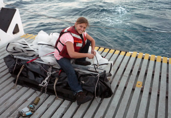 Meghan Powers prepares the trawl equipment.