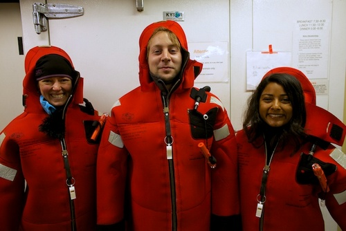 Olivia Judson, Zach Kobrinsky, and Danielle Haddock try on their immersion suits. Safety first!