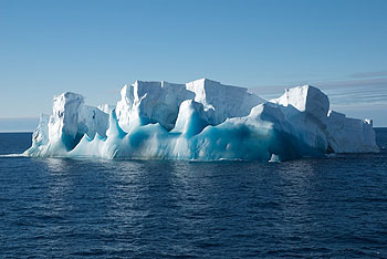 A small iceberg with old blue ice that was chosen for an ROV dive.