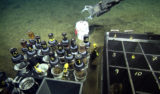 """At the end of the dive we deployed a """"tephra collector"""" for Bill Chadwick to collect ash particles that might advect from the plume during the next eruption at Axial (and whatever else lands on it in between)."""