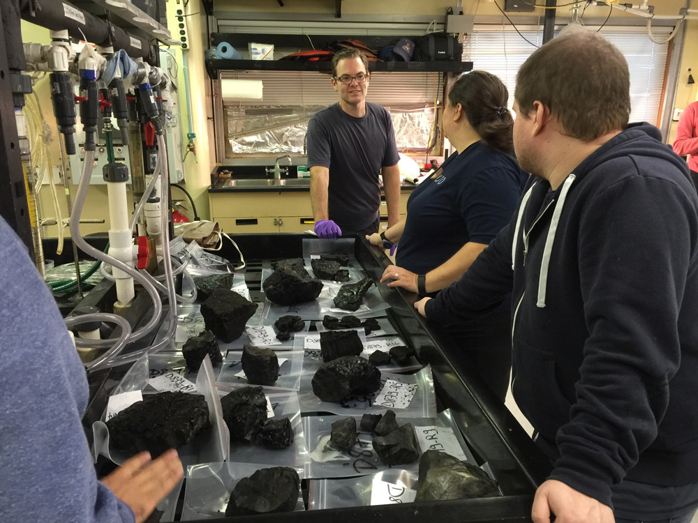 Brian talks about the lava samples we collected today with grad students Beth and Charles.