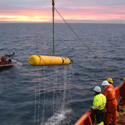 Researchers recover MBARI's seafloor mapping AUV after a deployment the Arctic Ocean.