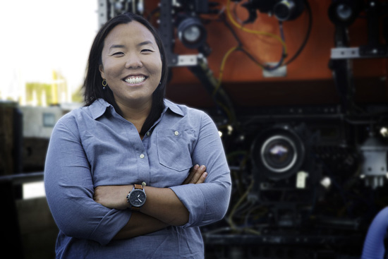 Postdoctoral Fellow Anela Choy standing in front of MBARI's remotely operated vehicle Ventana. Image courtesy of L'Oreal.