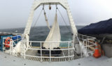 Panorama of the back deck. The trawl net hangs to dry on the A-frame. You can't tell from the image, but the wind came up to over 28 knots this afternoon.