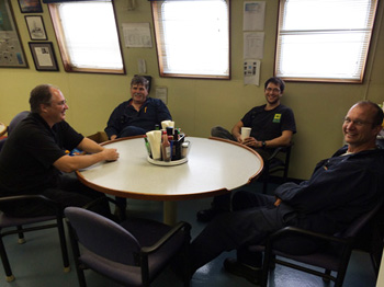 A rare photo of almost all of the ship's engineers having a very important meeting in the galley. These guys work very hard, but it is hard to capture all that they do in a photo because much of their work is below decks. From left, Electronics Officer Dan Chamberlain, Relief Chief Engineer Lance Wardle, Relief First Engineer Fred Peemoeller, Second Engineer Jason Jordan. Not pictured are Olin Jordan who was working his rounds and Chief Engineer Matt Noyes who got to take this cruise off.