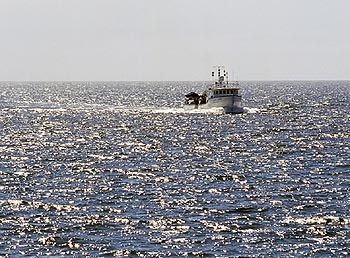 The research vessel Point Lobos returns to Moss Landing Harbor on a relatively calm afternoon. During spring and summer, afternoon winds on Monterey Bay often reach 10 to 13 meters per second (25 to 30 miles an hour)—strong enough to curtail scientific research and endanger small boats. Image: Todd Walsh (c) 2006 MBARI