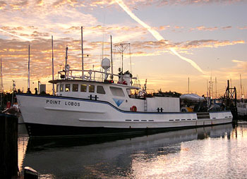 The research vessel Point Lobos heads away from the dock at dawn to spend another long day out on Monterey Bay. Image: Johnny Ferreira (c) 2006 MBARI