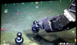 The robotic arm of the ROV Doc Ricketts pushes a core sampler into the muddy seafloor to collect sediment for analyses of the macrofauna (small worms and crustaceans) inhabiting the sediment. Over 60 cores were collected today, along with several fragile deep sea urchins. Our research team will use these collections to help understand the effects urchins have on the sediment-dwelling animals (macrofauna) as well as determine rates of growth and reproduction for the urchins.