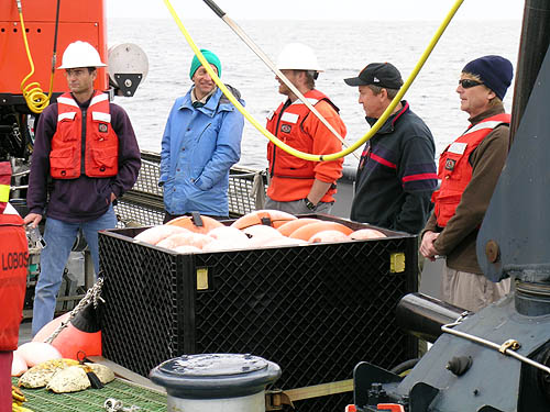 Members of the ESP team watched anxiously as the deep ESP was lowered over the side of the R/V Point Lobos for the first time. From left to right, the team members on the cruise included Scott Jensen, Brent Roman, Doug Pargett, Jim Birch, and Chris Scholin. Image: Kim Fulton-Bennett © 2009 MBARI
