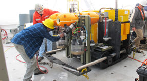 Ken Smith and John Ferreira inspect Benthic Rover on the deck of the Western Flyer.