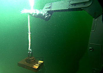 MBARI's remotely operated vehicle Ventana places a small anchor for scientific equipment on the bottom of Monterey Bay. Image: (c) 2000 MBARI
