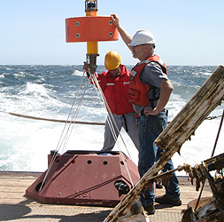 Researchers from the Naval Postgraduate School prepare to lower a current meter onto the seafloor off Monterey Bay as part of the ASAP experiment. Image: (c) 2006 Naval Postgraduate School