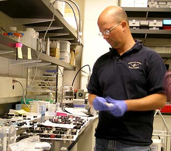 MBARI research technician Joe Jones examines a collection of sample-processing