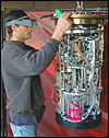 MBARI electrical engineer Scott Jensen prepares the environmental sample processor for its first deep-water sampling mission.