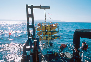 Deploying the fish trap in Monterey Bay using the J-frame on MBARI's research vessel Zephyr. Photo: Todd Walsh (c) 2004 MBARI