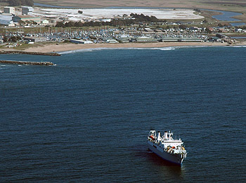 The cable-laying ship Global Sentinel just offshore of Moss Landing, laying the nearshore end of the MARS ocean obseratory cable. MBARI's campus is on the beach just behind the ship. Image: Todd Walsh (c) 2007 MBARI